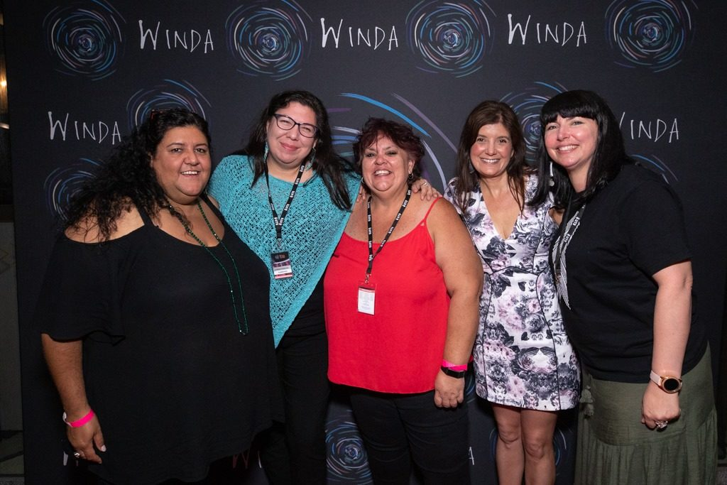 Jodie Bell standing in a group of people at Winda Film Festival