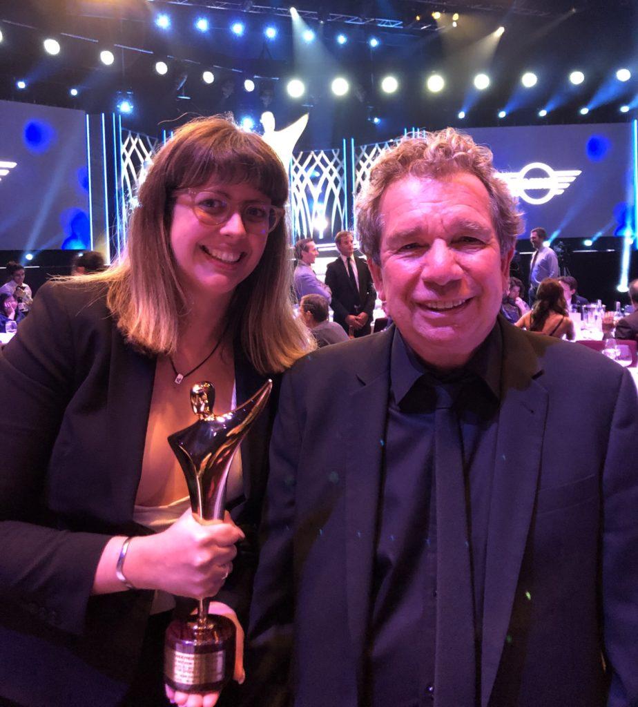 Xoe Baird and Ric Curtin holding their AACTA Award