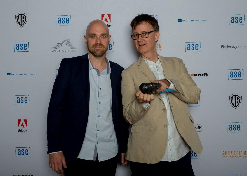 Shane Elsmore presenting an award to Nicholas Dunlop.