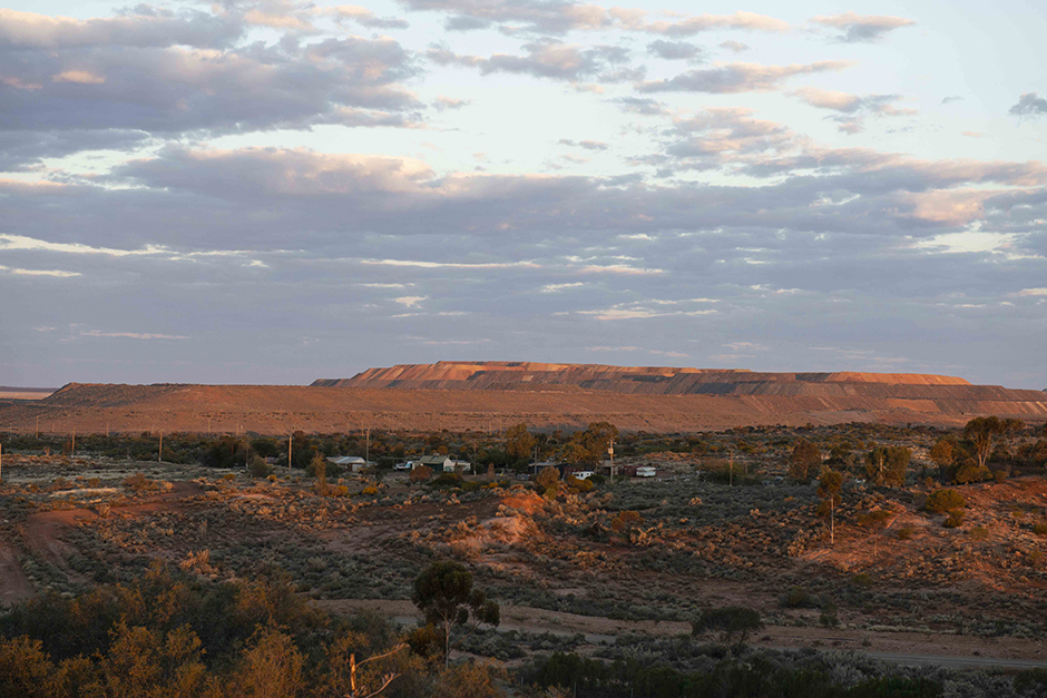 Rugged Kalgoorlie landscape with a sky full of clouds at sunset.