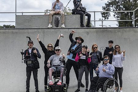 Different Lens Crew and Curtis Hatton at a skatepark with film equipment