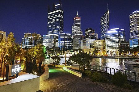 Buildings in City of Perth skyline lit up at night