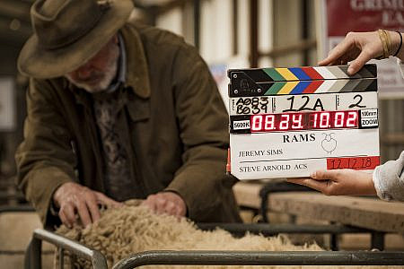 Film clapper with Sam Neil and a sheep in the background