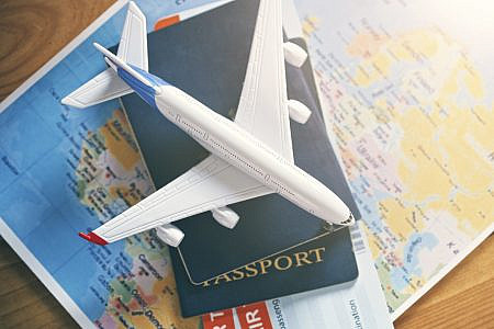 Plane model with world map, passports and tickets
