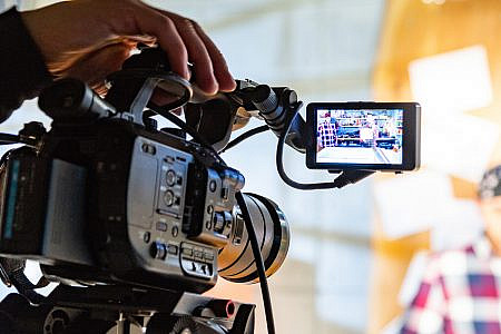 close up of a film camera viewfinder filming a person