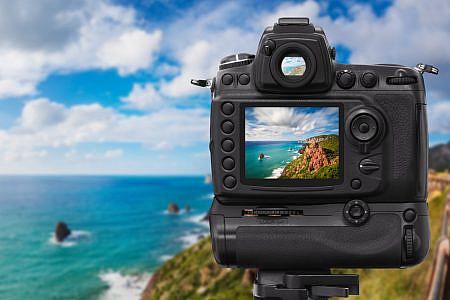 Digital SLR camera shooting a coastal landscape