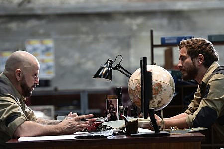 Terry (Anthony La Paglia) and Dougie (Ryan Corr) at desk in Below