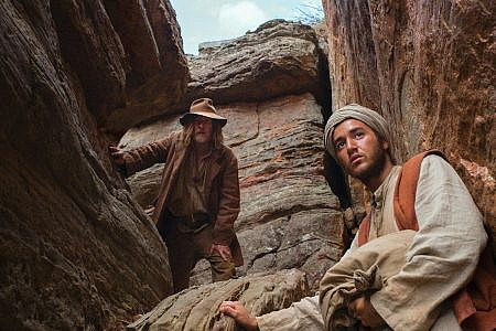 David Wenham as Mal and Ahmed Malek as Hanif in a gorge