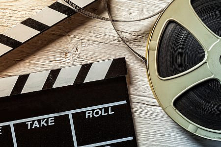 Close up of a film clapper and a film reel
