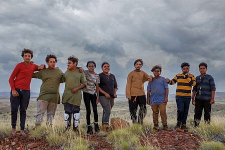 Cast of Red Dirt Riders standing outside in Roebourne