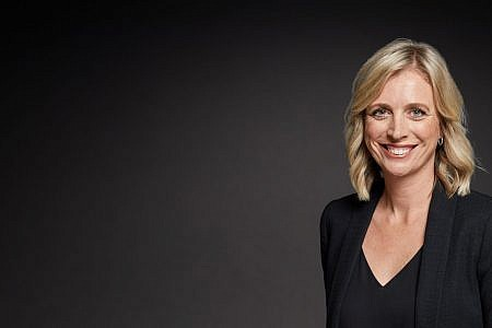 Headshot of Rikki Lea Bestall, Screenwest CEO. She has shoulder-length blonde hair, a black blazer and top and is smiling.